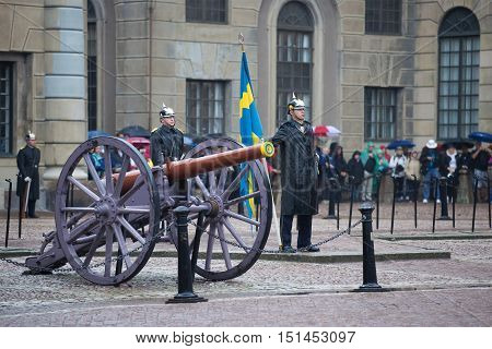 STOCKHOLM, SWEDEN - AUGUST 29, 2016: A standard bearer from the ancient artillery. The ceremony of changing of the guard at the Royal Palace. Historical landmark of the city Stockholm