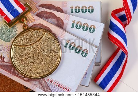 Gold Medal And Thai Money. Payment Sporting Achievements.