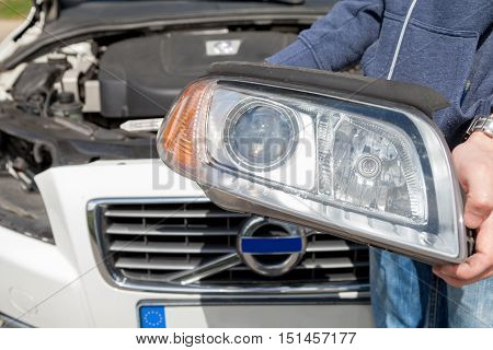 headlight removes from a white sports car