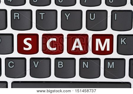 Getting scammed online A close-up of a keyboard with red highlighted text Scam