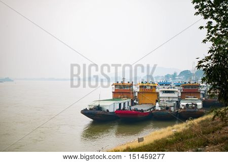 CHAINGRAI THAIILAND - MARCH 27: China Cargo ship dock on Mekong River in Chiang Saen district on March 27 2016 in Chaingrai Thailand.