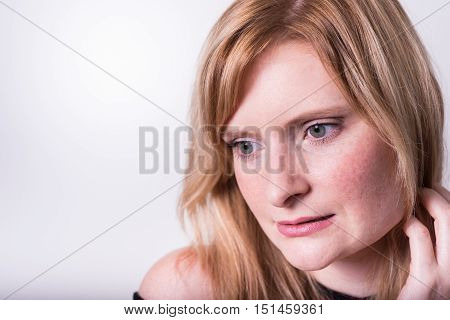 beautiful blonde woman looking down and dreaming