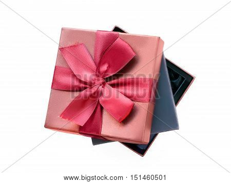 Gift boxes black one nesting in the brown one with gift ribbon. Isolated on white with clipping path