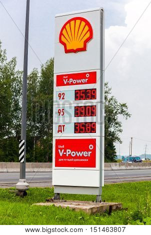 LENINGRAD REGION RUSSIA - JULY 31 2016: Guide sign indicated the price of the fuel on the gas station Shell. Shell is an Anglo-Dutch multinational oil and gas company