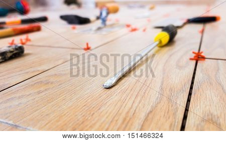 House Renovation Tools  On Yellow Ceramic Background