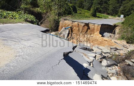 Road and pipes underneath washed away near Raeford North Carolina by Hurricane Matthew