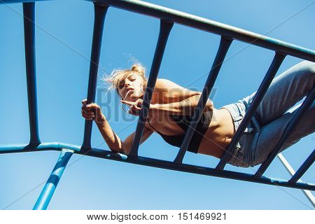 Sporty Fit Girl Working Out At Outdoor Gym