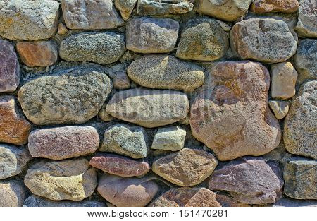 An old stone wall with colored stones