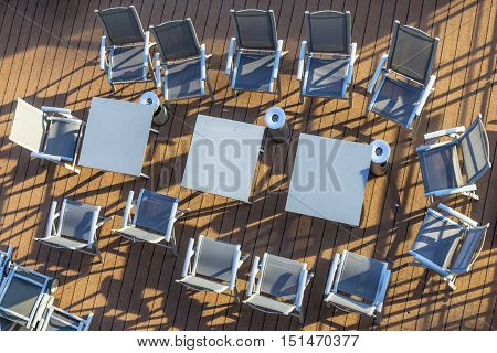 Arrangement Of Chairs And Tables On Deck Without People