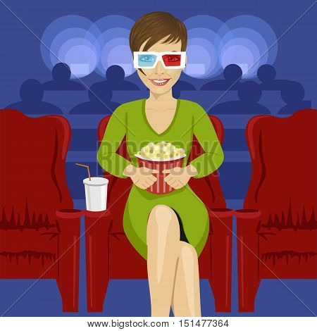 young woman sitting with popcorn in movie theater watching 3D movie and smiling