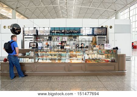 HONG KONG - NOVEMBER 03, 2015: agnes b. cafe l.p.g. at Hong Kong Airport. Hong Kong International Airport is the main airport in Hong Kong. It is located on the island of Chek Lap Kok.