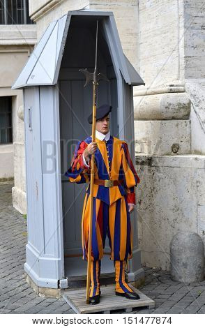 Rome Italy - September 15 2016 : A Swiss Guard posted at St. Peter's Basilica Vatican City