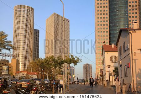 TEL AVIV, ISRAEL - APRIL 7, 2016 : Cityscape with towers of Azrieli Center and Sarona area in Tel Aviv, Israel. Azrieli center is the main landmark of Tel Aviv. Sunset light.