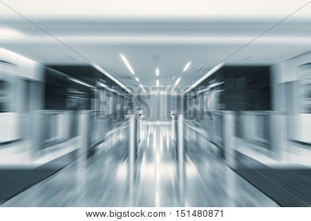 Blurred image of the turnstiles by the lifts of the modern business city office building.