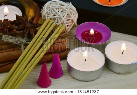 candles light with incenses for relax on wooden floor