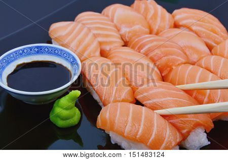 Wasabi with sushi and soy sauce on the bamboo mat  (lens blur,soft focus). Health Benefits of Wasabi wasabi fights off bacterial infection.