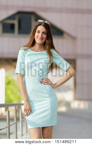 Happy beautiful smiling woman portrait looking at camera, outdoors