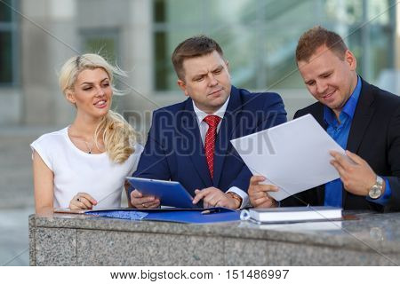 Image of friendly business team, two man and woman, discuss design project