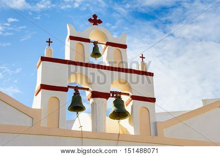 White orthodox church bell tower. Oia, Santorini Greece. Copyspace