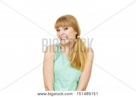 Funny uptight young woman teeth clenched about to have nervous breakdown reaction. Isolated on white. Negative human emotion facial expression feeling