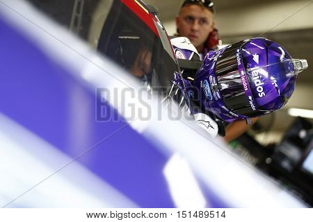 Concord, NC - Oct 06, 2016: Darrell Wallace Jr (6) hangs out in the garage during practice for the Drive for the Cure 300 at the Charlotte Motor Speedway in Concord, NC.