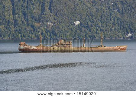 Rusting hulk of a shipwreck grounded in the Patagonian Channels of southern Chile