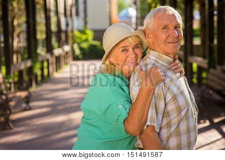 Senior woman hugs man. Smiling elderly couple. Life is full of happiness. So many years together.
