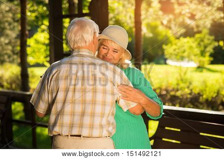 Old couple dancing. Lady with closed eyes smiling. Time goes by so fast. Save your love.