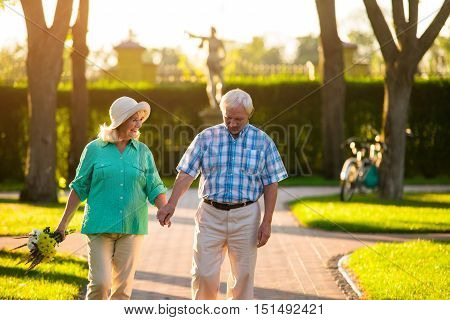 Senior couple holding hands. Man and woman outdoors. Glad to be with you. Magic of feelings.