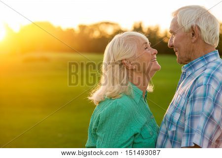 Elderly couple smiling. Woman and man outdoor. Feelings grow stronger. The loving wife.