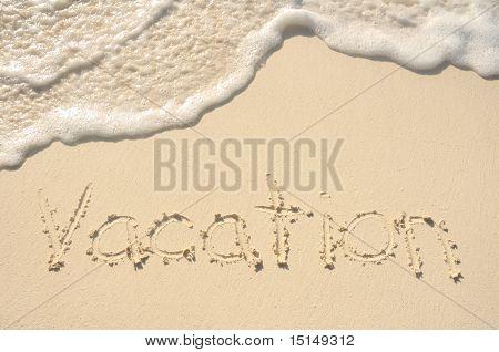 Vacation Written In Sand On Beach