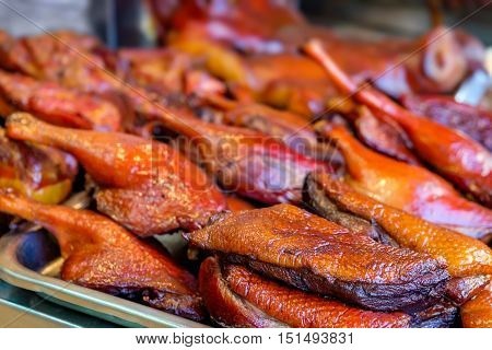 Peking duck roasted for sale in the most famous market in Chinatown district Bangkok Thailand. Traditional chinese cuisine.