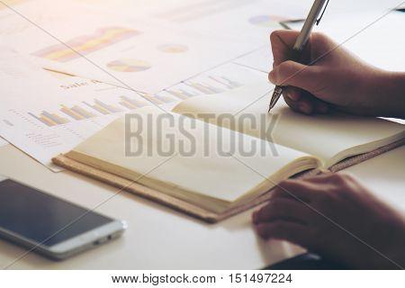 Business Women Signature At Document