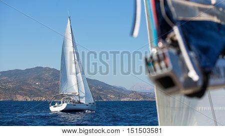 Sailboats during a race near the Greek Islands. Cruise luxury Yacht.