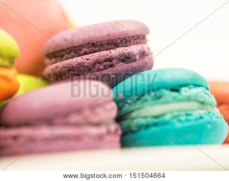 A french sweet delicacy macaroons variety closeup.macaroon colourful texture soft focus