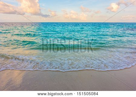 Beautiful sunrise with sky over calm sea  in tropical Maldives island