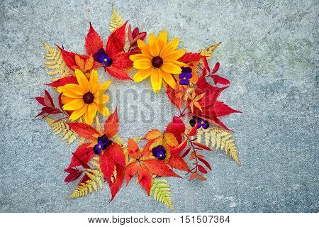 A Wreath Of Autumn Leaves And Flowers On A Neutral Gray Background, With Copy Space Suitable For Ins