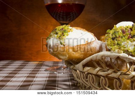 Traditional Sicilian cannoli in a wicker basket on the table