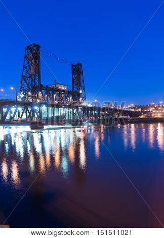 Water passes under the Steel Bridge in Portland at night