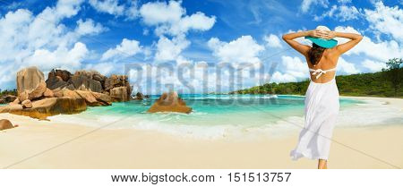 Beautiful woman's body from backside view over beach background. Travel and relaxation concept