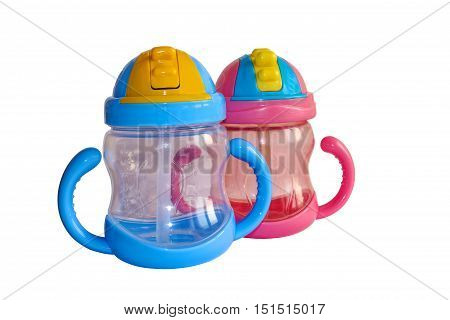 Baby bottle isolated on a white background. Two bottles with a straw. Sippy cups for water and milk for children.