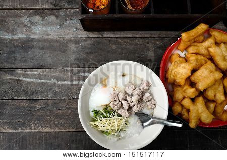 Rice porridge/congee with minced pork and Youtiao Thai rustic street food. Top view