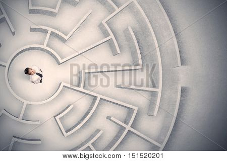 Confused business man trapped in a circular maze
