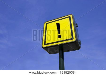 Yellow Sign Up Against Blue Sky with text saying exclamation mark