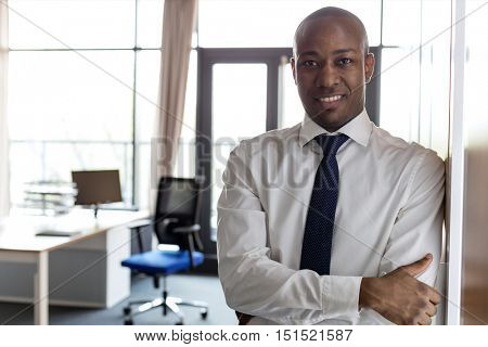 African American Business Man standing with his arms folded standing proudly in front of his office