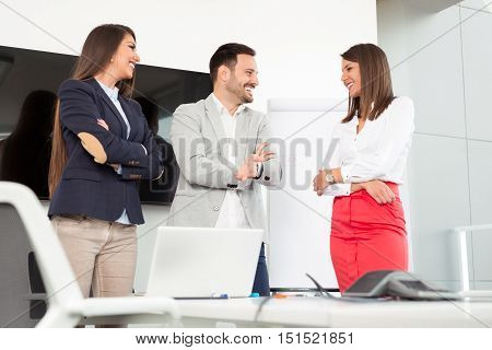 Business people in office holding a conference and discussing strategies