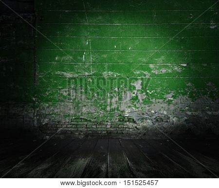 old room with concrete wall and wooden floor, green background