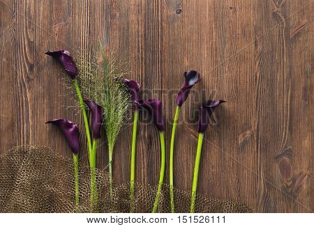 calla lily on rustic wooden table