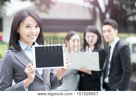 business people show tablet shot in hongkong asian