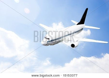An Airplane Flying In The Blue Sky
